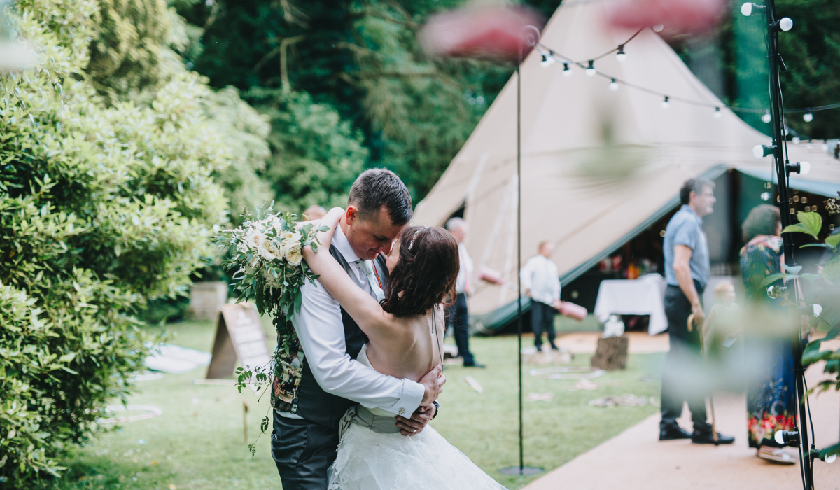 Healing Manor Hotel Grimsby Gardens tipi wedding kiss