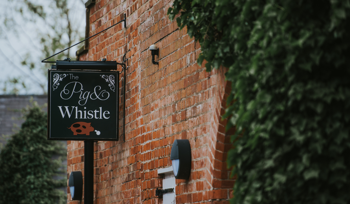 The Pig and Whistle Pub near Grimsby pub sign